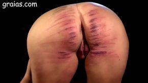 Bruneta batuta cu biciul e legata de maini si de picioare sex brutal